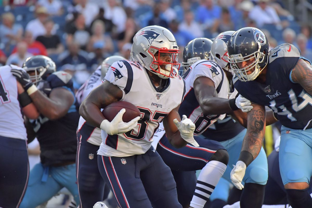 New England Patriots running back Damien Harris rushes against the Tennessee Titans during the first half at Nissan Stadium.