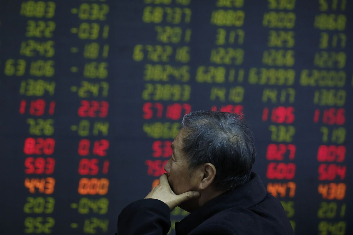 An investor monitors stock prices at a brokerage house in Beijing, Wednesday, Oct. 24, 2018. Asian markets are mixed on Wednesday after U.S. companies, including those that outperformed in the third quarter, cautioned against escalating a trade dispute wi