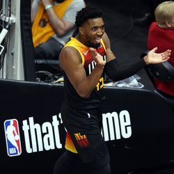 Utah Jazz guard Donovan Mitchell (45) cheers after being fouled and making the shot as the Utah Jazz and Memphis Grizzlies play Game 2 of their NBA playoffs first round series at Vivint Arena in Salt Lake City on Wednesday, May 26, 2021.