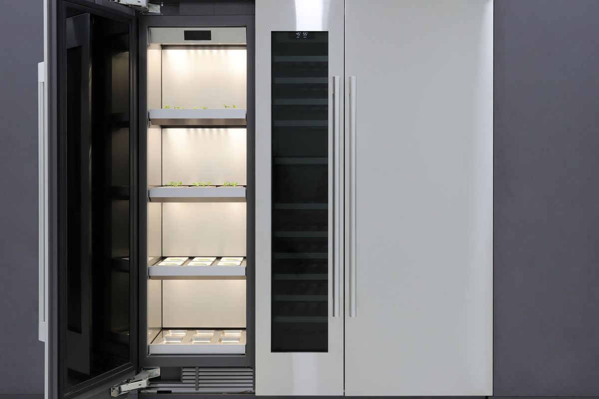 Refrigerator with side panel for growing plants.