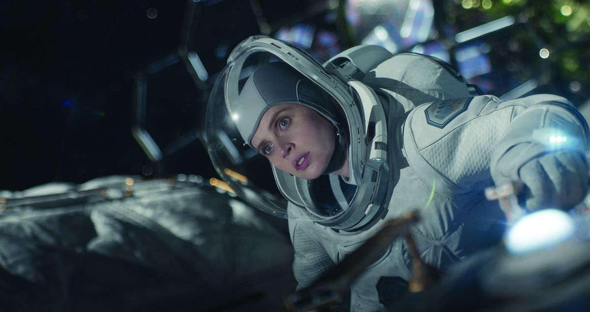 Felicity Jones floats in space in a space suit in The Midnight Sky
