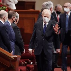President Russell M. Nelson, of The Church of Jesus Christ of Latter-day Saints, waves to leaders prior to the Sunday afternoon session of the 191st Semiannual General Conference in the Conference Center in Salt Lake City on Sunday, Oct. 3, 2021.