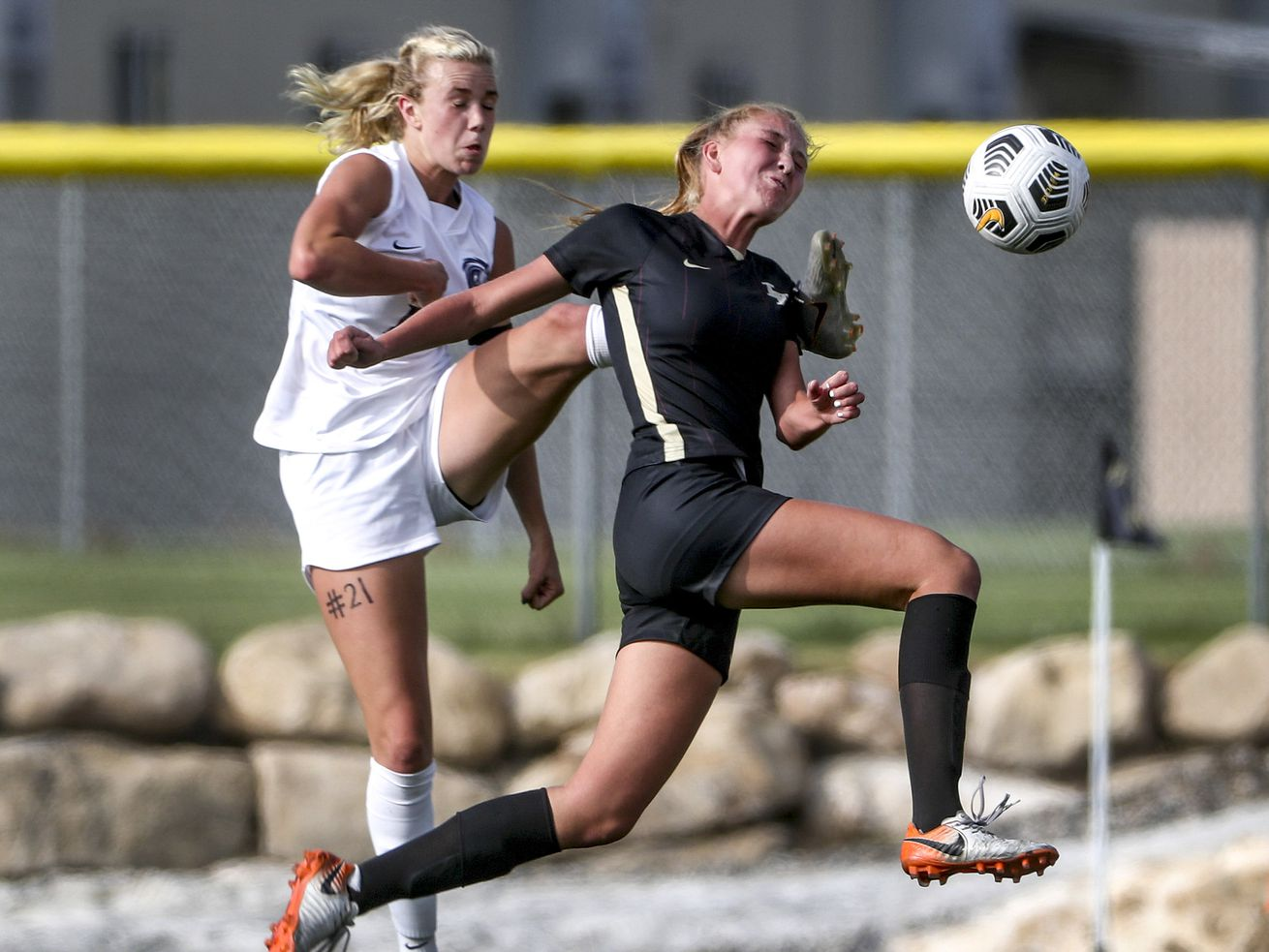 Corner Canyon's Reagan Winget, left, kicks the ball away from Lone Peak's Ellie Tadje during a girls soccer game at Lone Peak High School in Alpine on Tuesday, Sept. 15, 2020.