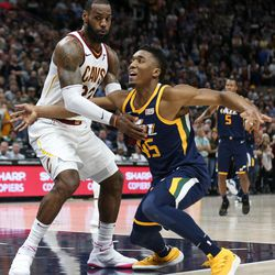 Cleveland Cavaliers forward LeBron James (23) is charged with a foul as he guards Utah Jazz guard Donovan Mitchell (45) in the final moments of the game at Vivint Arena in Salt Lake City on Saturday, Dec. 30, 2017.
