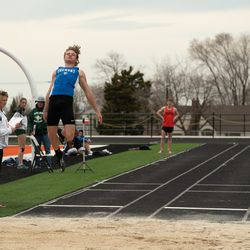 Fremont High's Logan Tittle competes in the long jump.