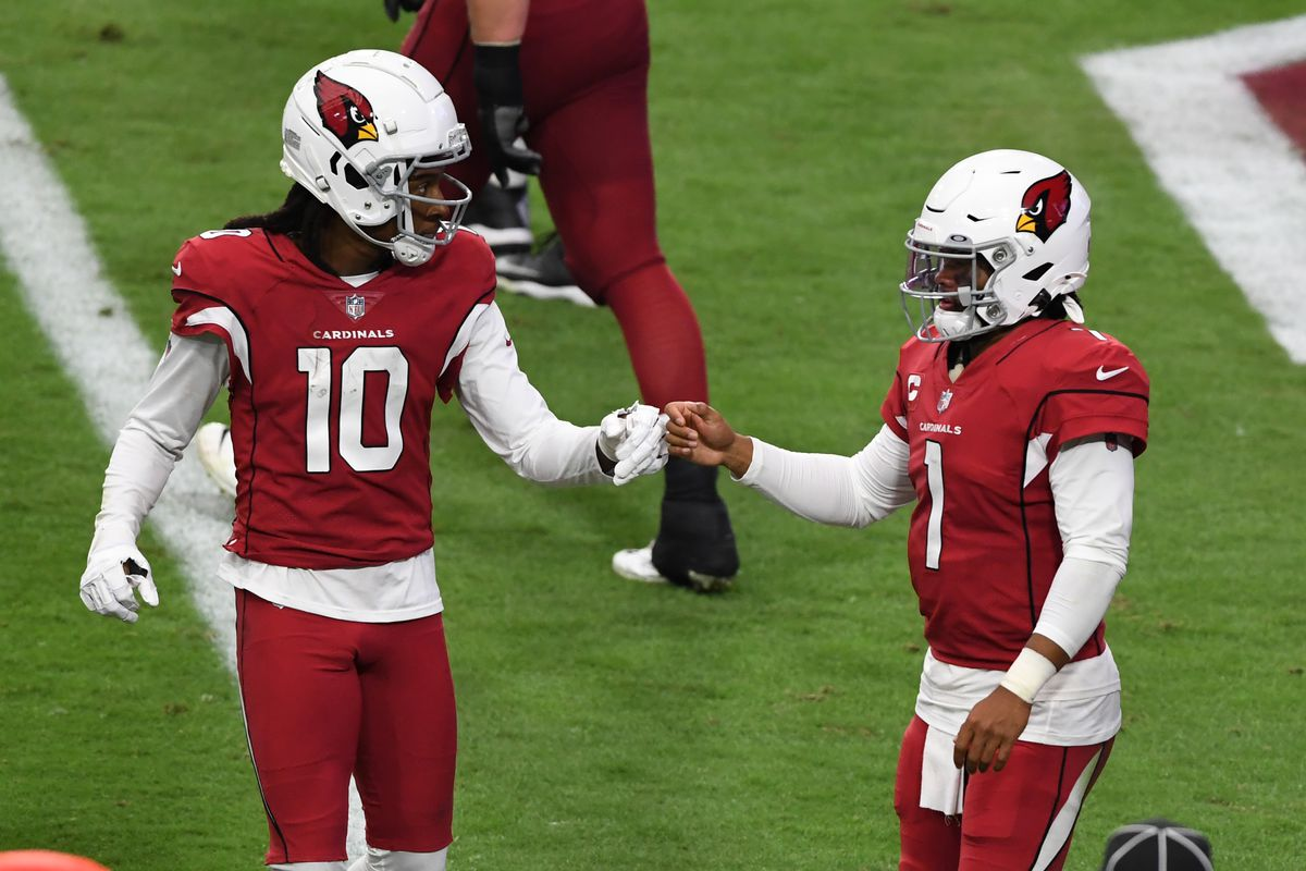 Kyler Murray of the Arizona Cardinals celebrates with DeAndre Hopkins after scoring his second touchdown of the game against the Washington Football Team during the fourth quarter at State Farm Stadium on September 20, 2020 in Glendale, Arizona. Cardinals won 30-15.