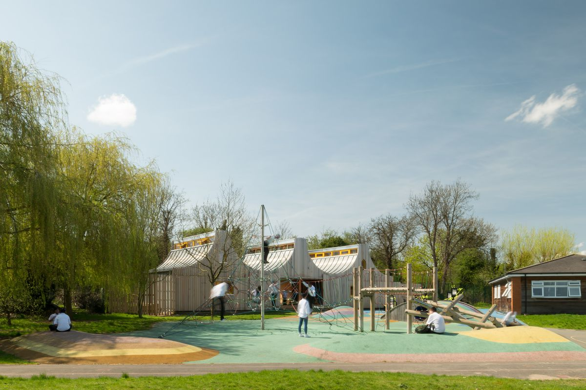 Exterior of timber school and playground