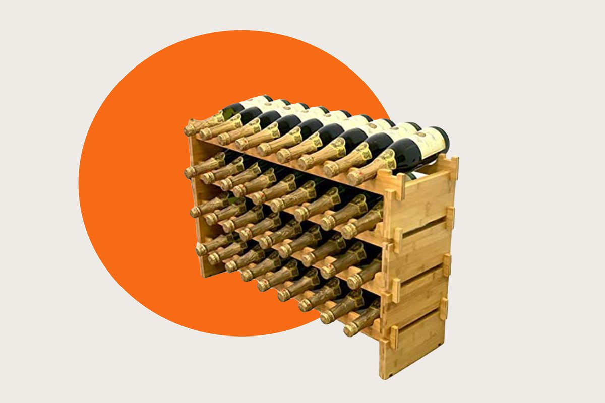 A wooden wine rack filled with Champagne bottles