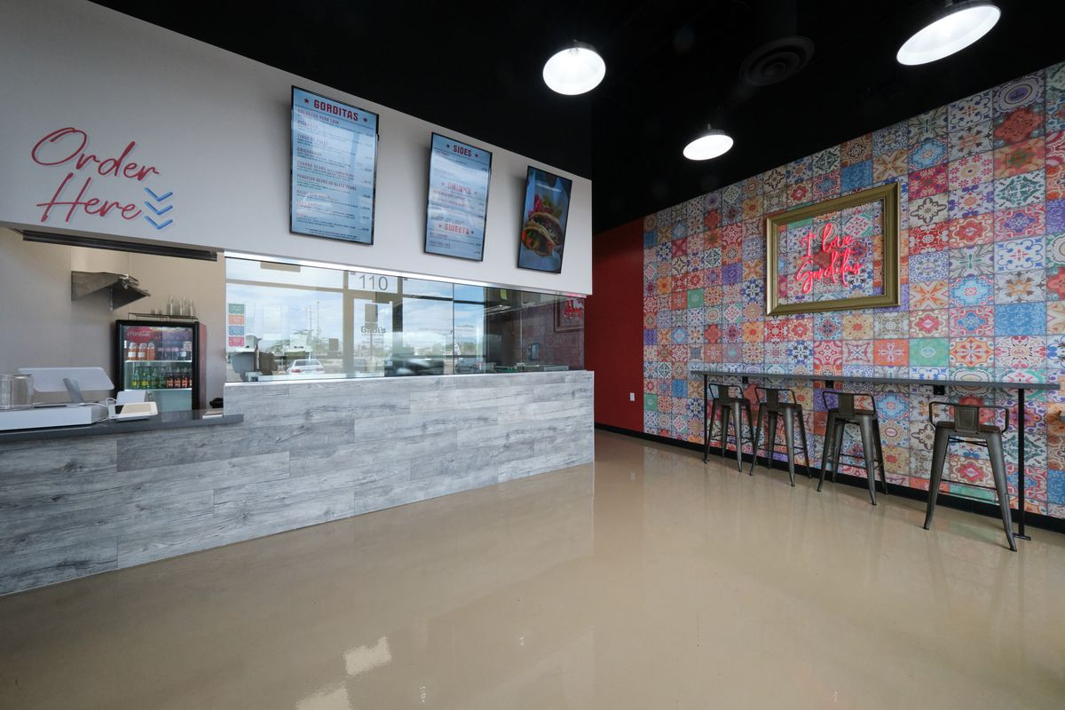 A counter-service restaurant with a quilt-like wall on the right