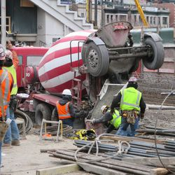 Concrete being poured along Waveland