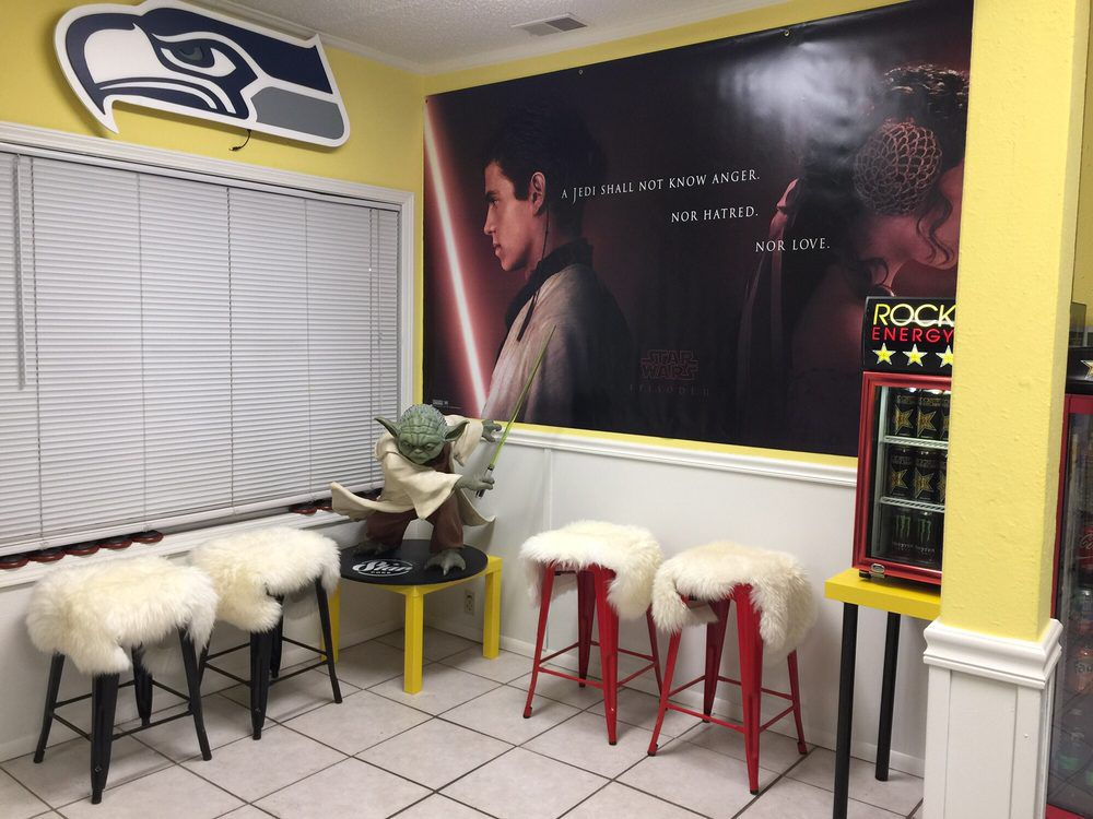 A Seahawks poster and a Star Wars poster along with a figure of Yoda in Star Poke.