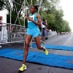 Teyba Naser finishes first in the women's division of the Deseret News 10K race that started in Research Park and ended in Liberty Park in Salt Lake City Saturday.