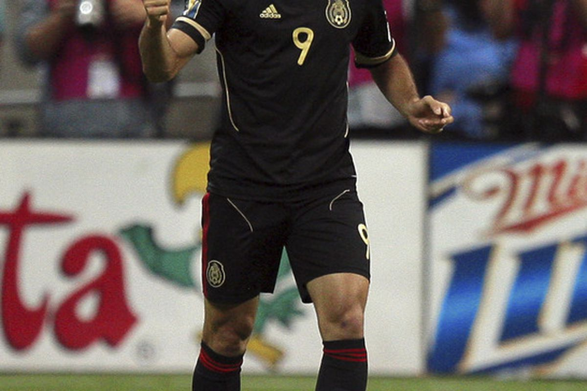 HOUSTON - JUNE 22:  Aldo De Negris #9 of Mexico celebrates scoring in the first overtime period against Honduras at Reliant Stadium on June 22, 2011 in Houston, Texas. Mexico won 2-0.  (Photo by Bob Levey/Getty Images)