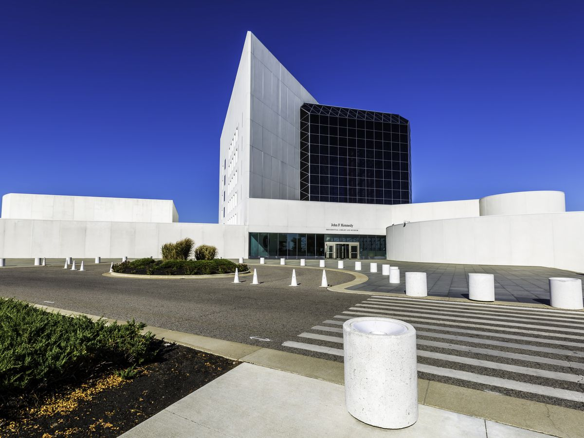 A modern building housing the John F. Kennedy Presidential Library and Museum on Boston's waterfront.