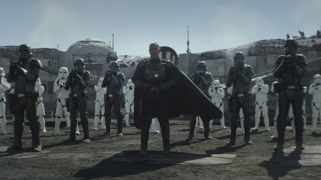 Moff Gideon (Giancarlo Esposito) delivers his ultimatum to the Mandalorian, surrounded by his contingent of Death Troopers.