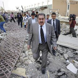 Iraqi Foreign Minister Hoshyar Zebari, center, inspects damage to the ministry complex after a bombing in Baghdad, Iraq, Saturday. Zebari said Saturday that those who carried out bombings that targeted government buildings in the Iraqi capital received help to pull off the attacks, possibly from Iraqi security forces.