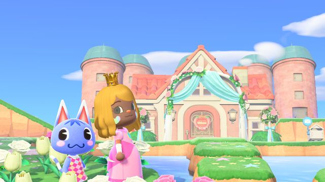 An Animal Crossing villager dressed as Princess Peach stands in front of a pink castle.