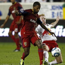 HARRISON, NJ - SEPTEMBER 21:  Andy Williams #77 of the Real Salt Lake and Dax McCarty #11 of the New York Red Bulls fight for the ball during their game at Red Bull Arena on September 21, 2011 in Harrison, New Jersey.  (Photo by Jeff Zelevansky/Getty Images)