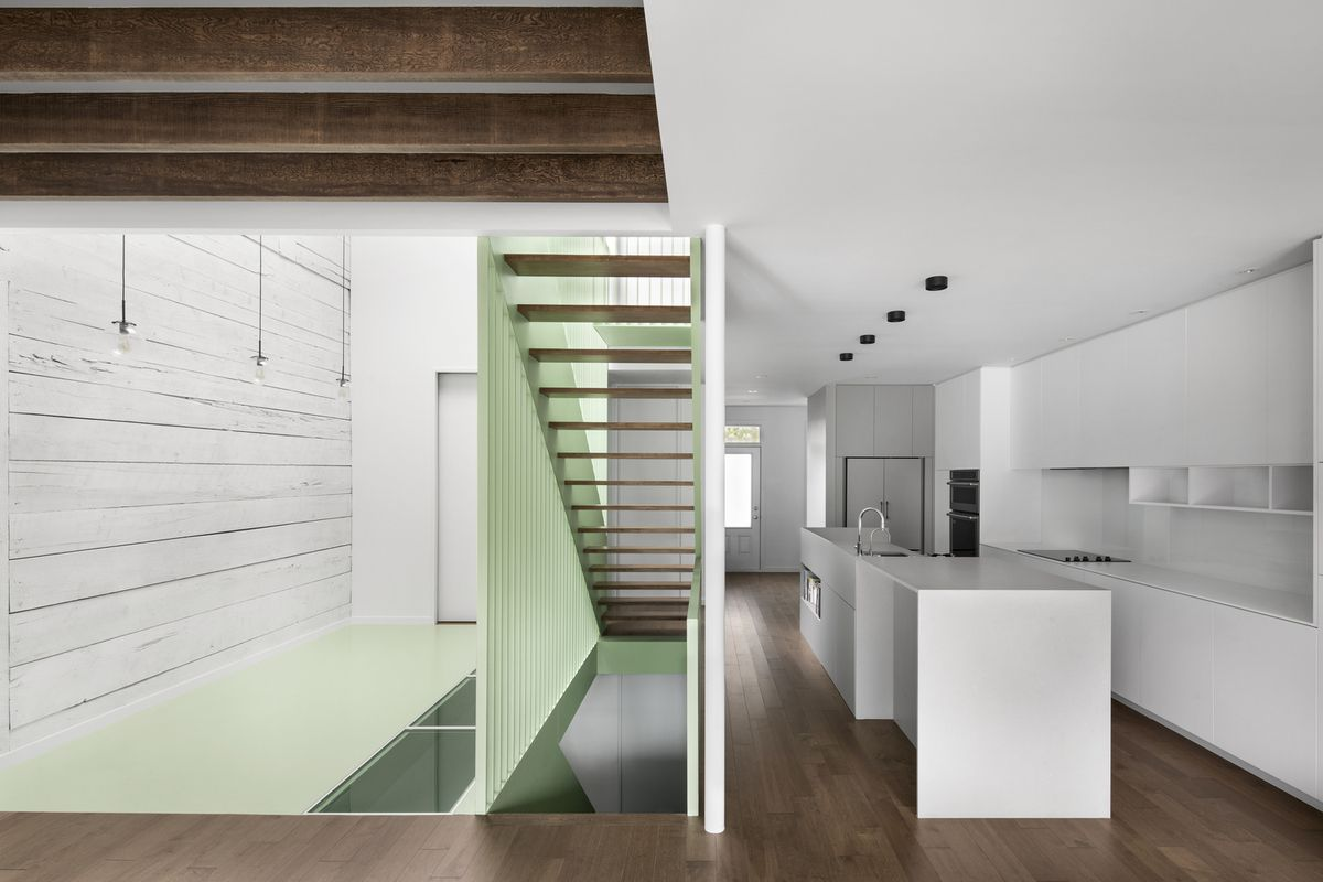 Kitchen with green staircase cutting through.