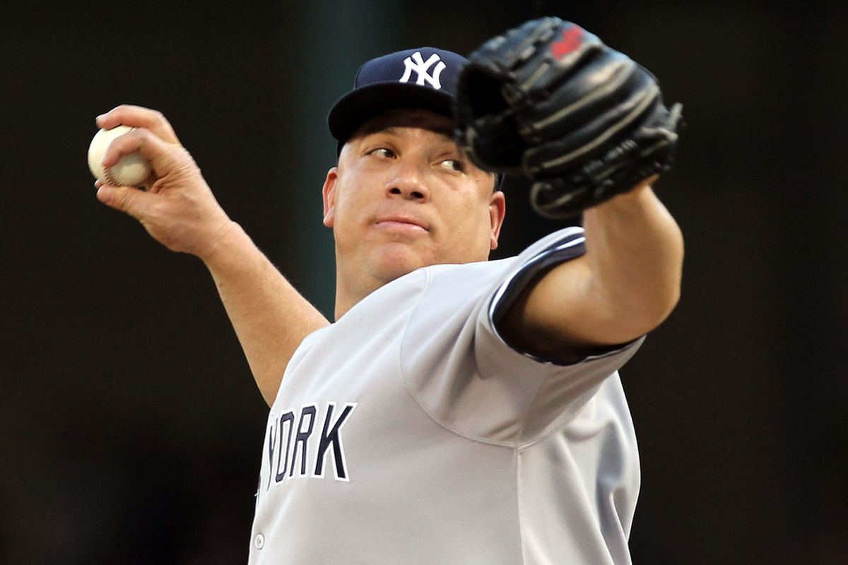 ARLINGTON, TX - MAY 07:  Pitcher Bartolo Colon #40 of the New York Yankees throws against the Texas Rangers in the first inning at Rangers Ballpark in Arlington on May 7, 2011 in Arlington, Texas.  (Photo by Ronald Martinez/Getty Images)