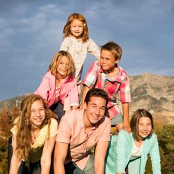 Fifteen-year-old Levi Hilton poses with his siblings for a family photo.