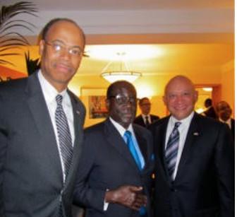 From left, former U.S. Rep. Mel Reynolds, Zimbabwe leader Robert Mugabe and Chicago businessman Elzie Higginbottom in New York City in September 2011. | Supplied photo