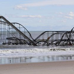 A rollercoaster that once sat on the Funtown Pier in Seaside Heights, N.J., rests in the ocean on Wednesday, Oct. 31, 2012 after the pier was washed away by superstorm Sandy which made landfall. (AP Photo/Julio Cortez)