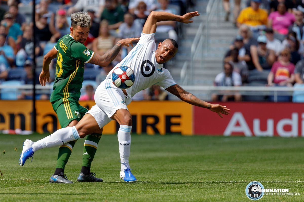 August 4, 2019 - Saint Paul, Minnesota, United States - Portland Timbers defender Julio Cascante (18) and Minnesota United forward Angelo Rodriguez (9) jostle for the ball during the Minnesota United vs Portland Timbers match at Allianz Field.