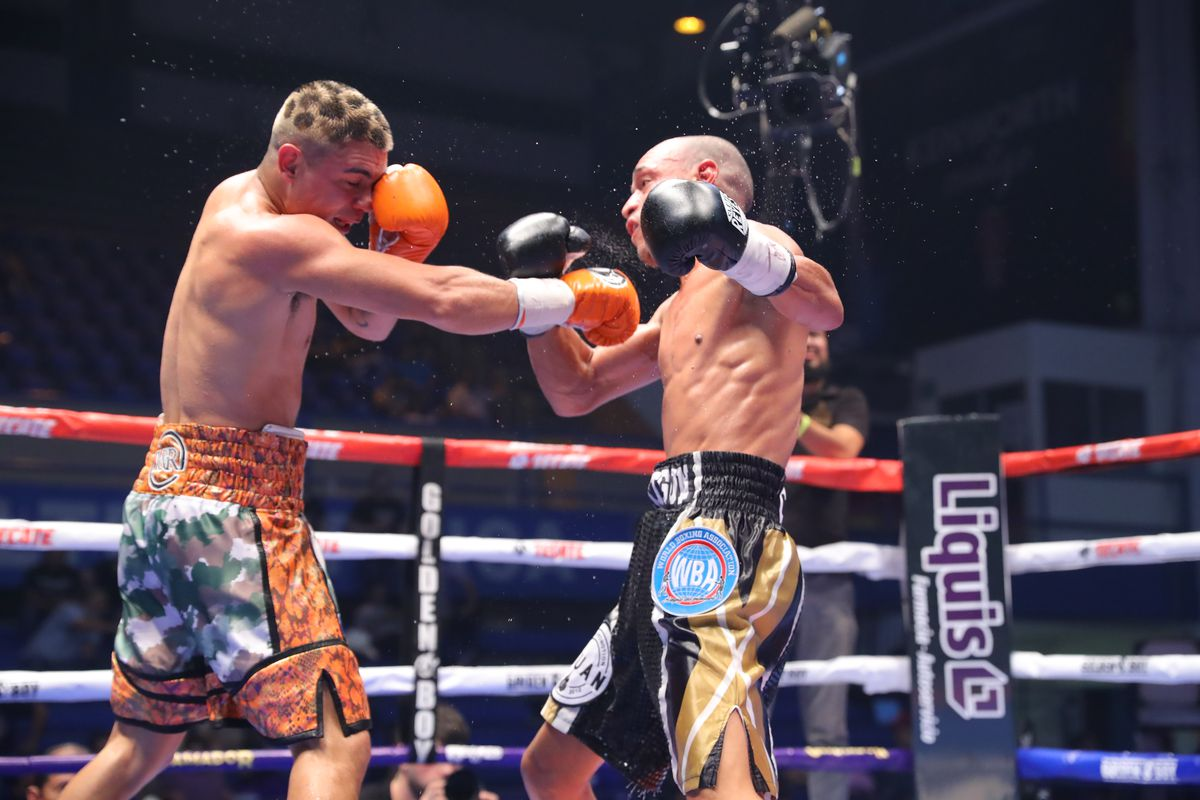 Joseph Diaz Jr.(L) punches Jesus Cuadro (R) during their super featherweight bout at the Auditorio del Estado on September 21, 2019 in Mexicali, Mexico.