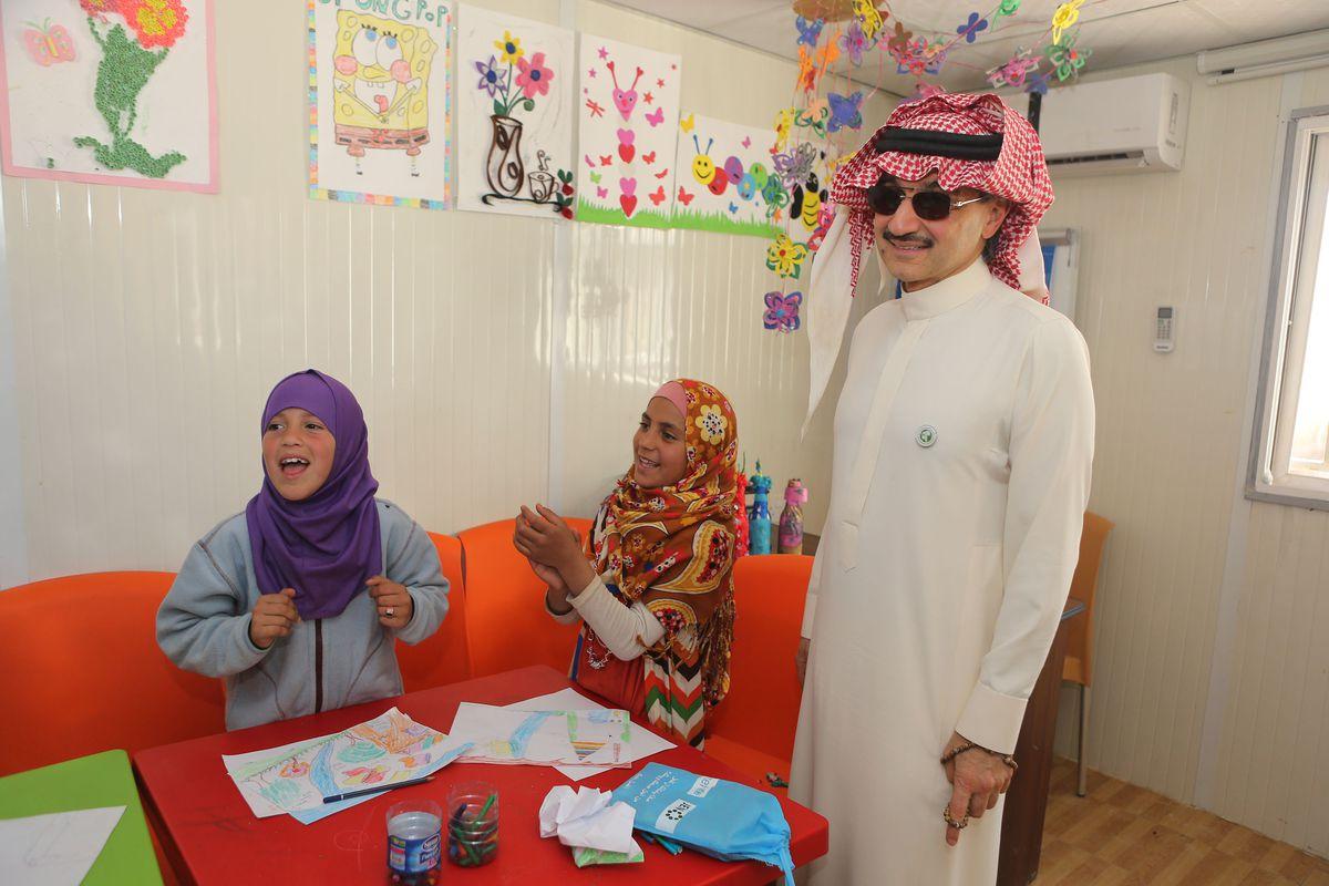 Saudi Prince Alwaleed bin Talal visits a refugee camp for Syrian refugees in Jordan.
