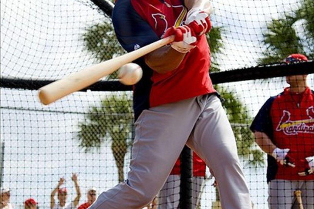Mar 1, 2012; Jupiter, FL. USA; St. Louis Cardinals right fielder Carlos Beltran (3) hits in the cage during spring training at Roger Dean Stadium. Scott Rovak-US PRESSWIRE