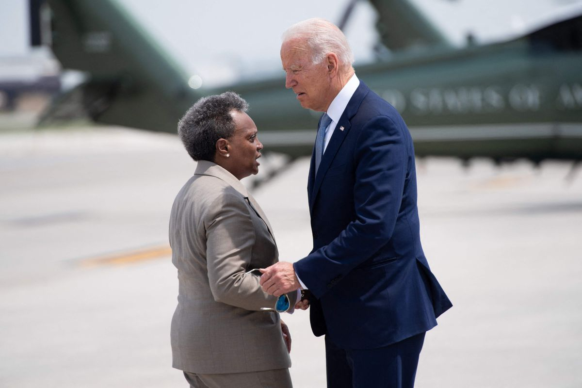 President Joe Biden greets Mayor Lori Lightfoot as he disembarks from Air Force One upon arrival at O'Hare International Airport on Wednesday.