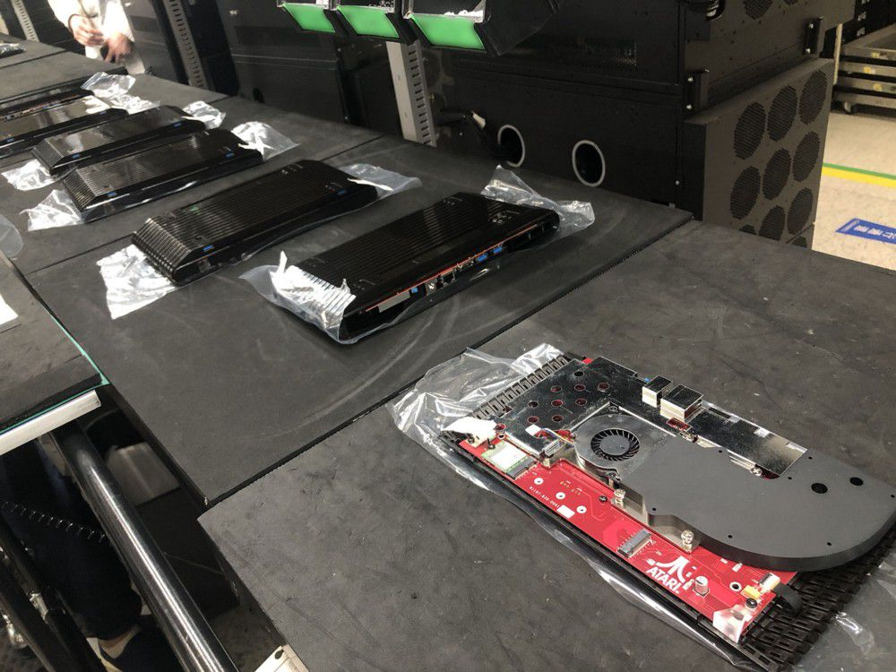 A row of consoles on an assembly line