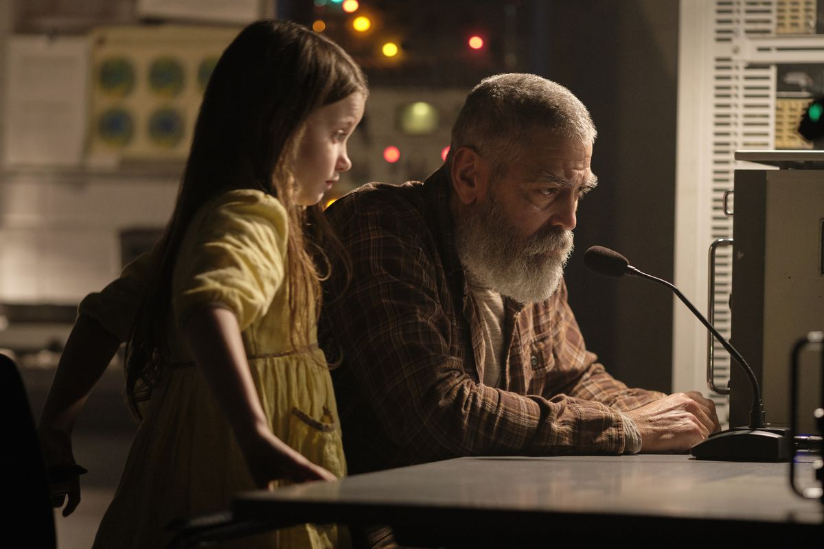 A bearded George Clooney and a little girl sit at a microphone hoping to contact a space station in The Midnight Sky