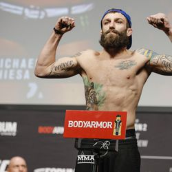 Michael Chiesa poses at UFC 232 weigh-ins.