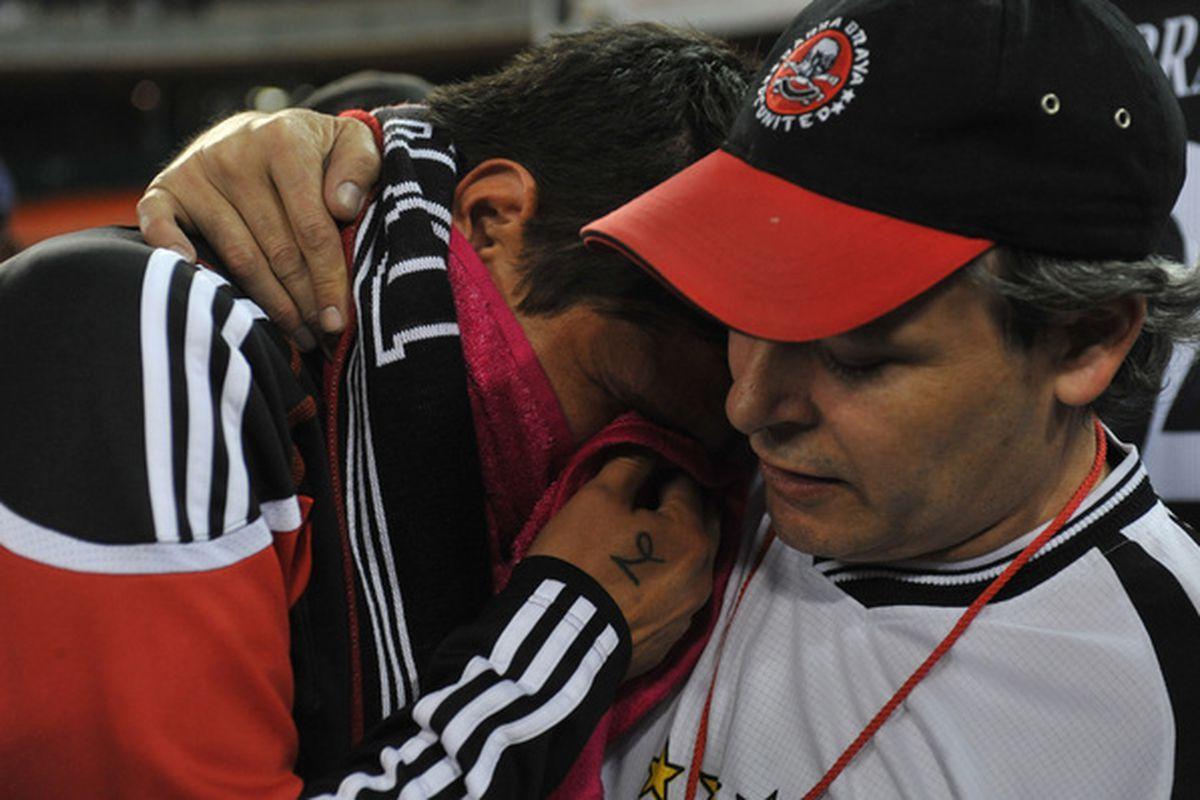 Jaime Moreno of D.C. United hugs Oscar Zambrana founder of Barra Brava