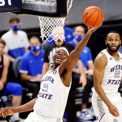 Weber State Wildcats center Dontay Bassett (21) grabs a rebound as BYU and Weber State play an NCAA basketball game at Vivint Smart Home Arena in Salt Lake City on Wednesday, Dec. 23, 2020. BYU won 87-79.