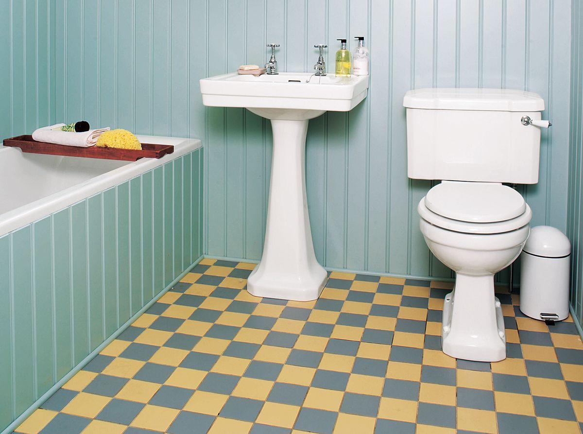 Yellow and grey checkerboard bathroom floor.