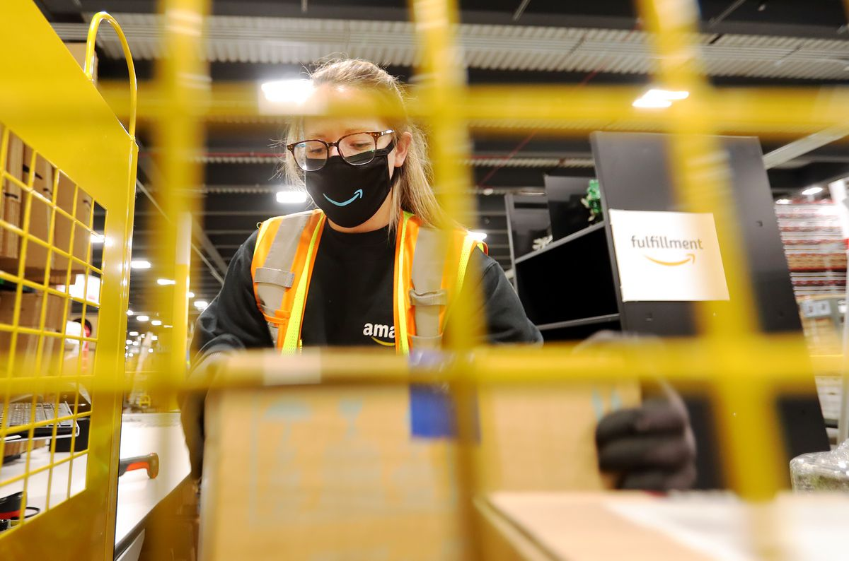 Raelee Whipple, process assistant at the newly opened Amazon fulfillment center in South Jordan, works to move packages through the system on Monday, Sept. 14, 2020.