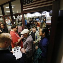Hundreds turn out to obtain marriage licenses Friday, Dec. 20, 2013, in the Salt Lake County offices after a federal judge ruled that Amendment 3, Utah's same-sex marriage ban, is unconstitutional.