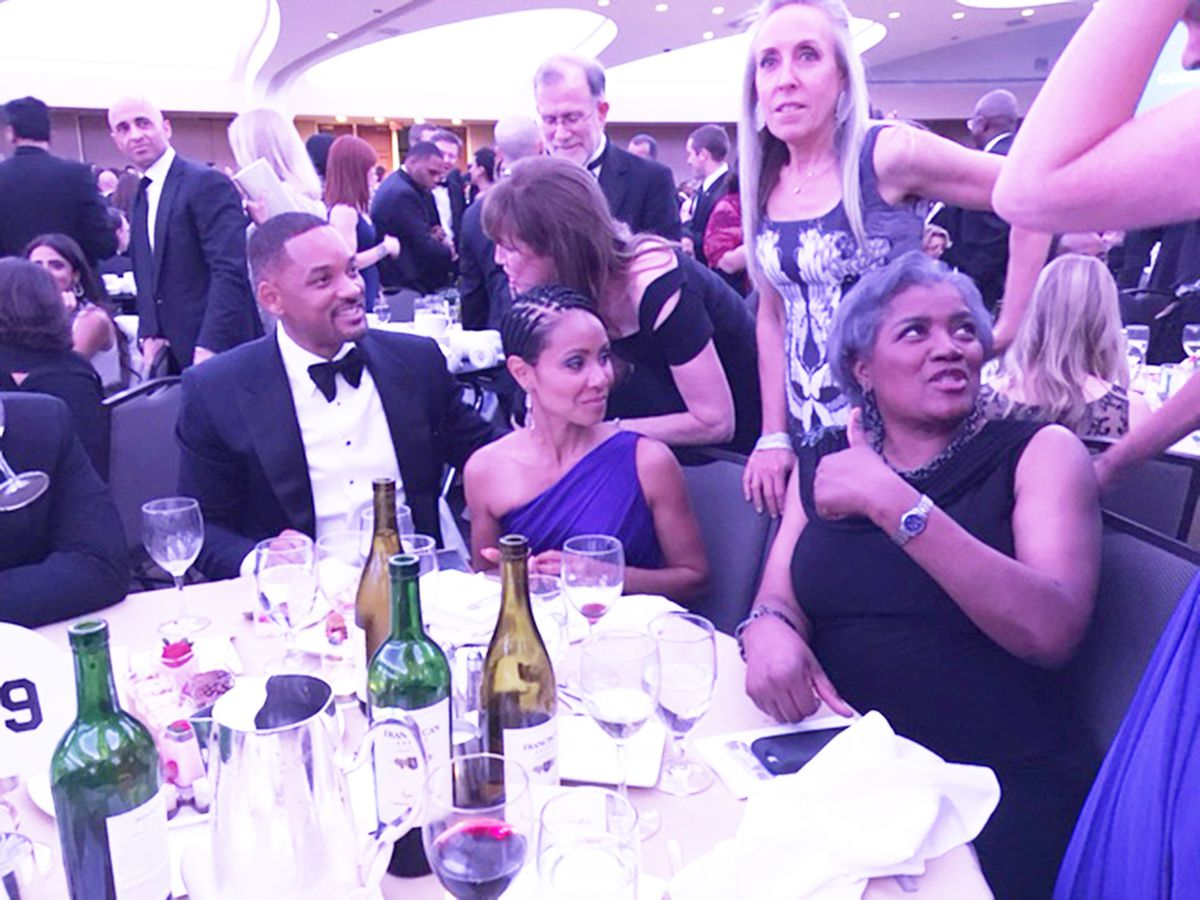 Will Smith (left) at the dinner with his wife, Jada Pinkett Smith and Democratic strategist Donna Brazile.   Lynn Sweet