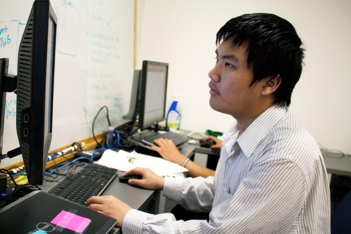 Denver student Quang Nguyen works at an internship this past summer.