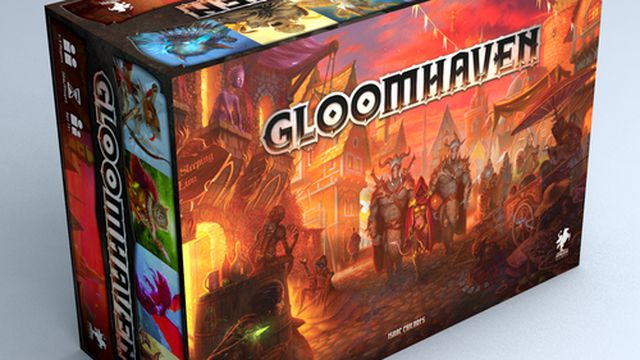 The box for the Gloomhaven tabletop game. It's one of the heaviest games ever sold art retail, coming in at close to 20 pounds shipping weight. The cover art is warm and colorful, depicting a party of four heroes striding down a crowded street in a small