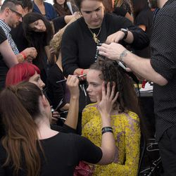A model is worked on, backstage ahead of the Spring/Summer 2013 Meadham Kirchoff collection at a central London  venue, during London Fashion Week, Tuesday, Sept. 18, 2012.