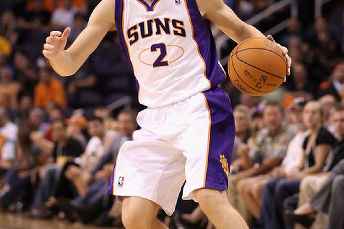 PHOENIX - OCTOBER 19:  Goran Dragic #2 of the Phoenix Suns handles the ball during the preseason NBA game against the Golden State Warriors at US Airways Center on October 19 2010 in Phoenix Arizona. (Photo by Christian Petersen/Getty Images)