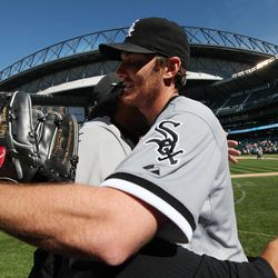 Chicago White Sox starting pitcher Phil Humber, right, is hugged after pitching a perfect baseball game against the Seattle Mariners, Saturday, April 21, 2012, in Seattle. The White Sox won 4-0.