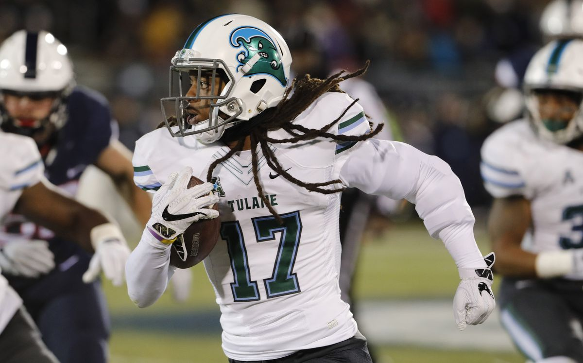 EAST HARTFORD, CT: Tulane Green Wave cornerback Parry Nickerson (17) fields an interception against the Connecticut Huskies at Rentschler Field.