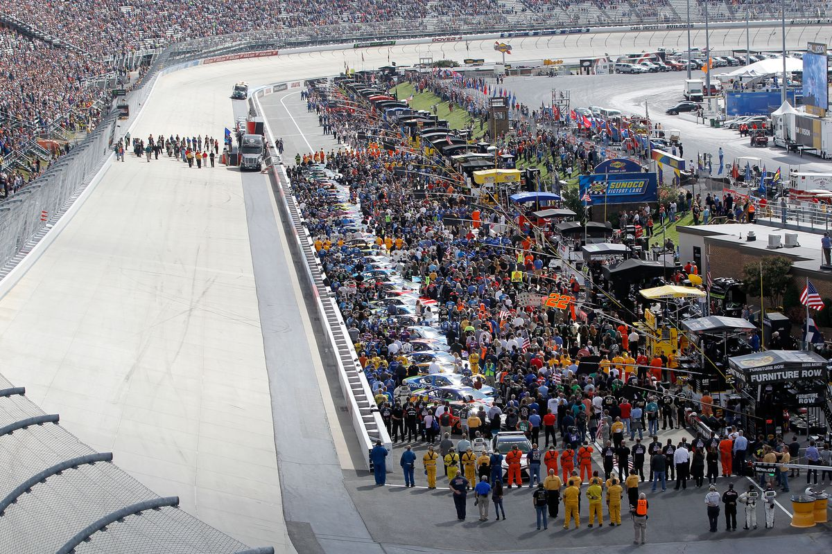 A general view of pit road during the National Anthem prior to the Monster Energy NASCAR Cup Series Apache Warrior 400 presented by Lucas Oil at Dover International Speedway on October 1, 2017 in Dover, Delaware.