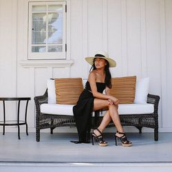 """Olivia of <a href=""""http://lusttforlife.com""""target=""""_blank"""">Lust for Life</a> is wearing an H&M hat, an American Apparel bandeau, a Reformation skirt and Miu Miu Sandals."""