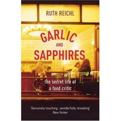 <em>Garlic and Sapphires</em> by Ruth Reichl is fascinating peek inside the world of a New York Times restaurant reviewer, who wears disguises and exposes the truths behind kitchen doors. You won't be able to put it down.